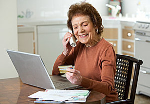 Senior at Laptop with Credit Card